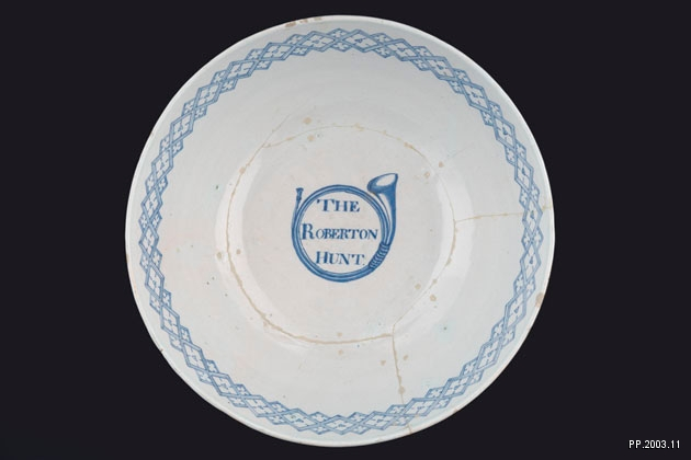 image of the inscription inside a blue and white delftware punch bowl